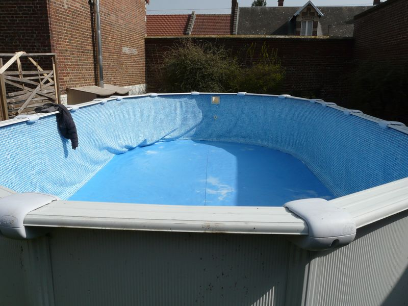 J 39 enterre ma piscine hors sol piscines r alisations for Piscine en tole rectangulaire