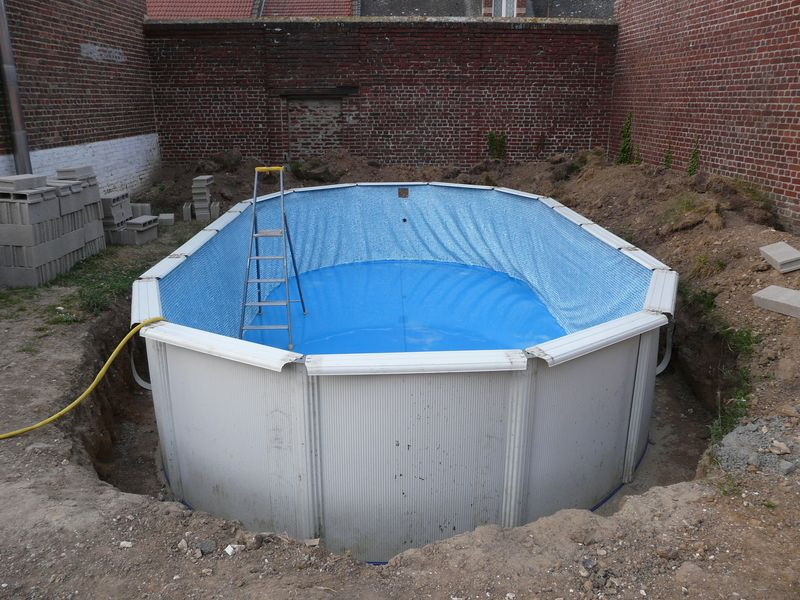 Enterrer piscine hors sol for Piscine bois a enterrer